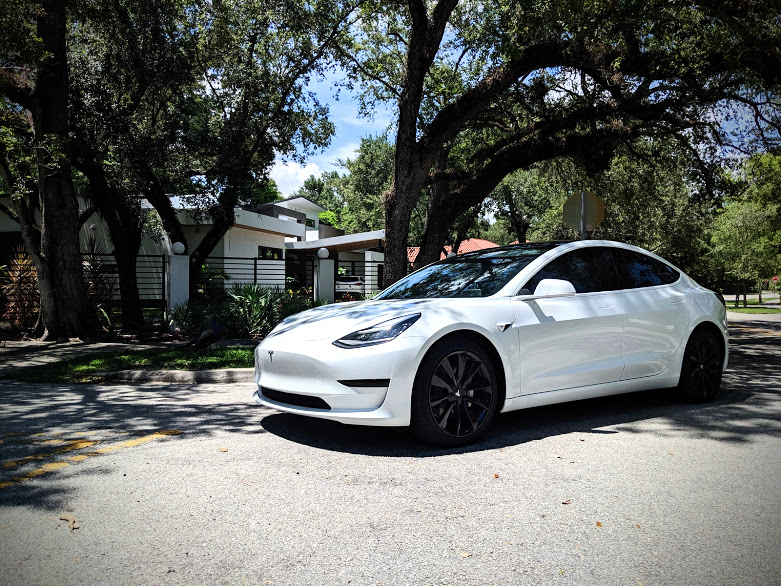 covering my tesla miami model 3 pearl wrap